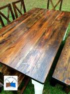 Reclaimed wood farmhouse table with repurposed porch post legs and handmade chairs.